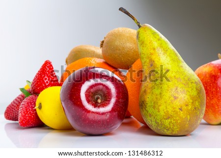 Fresh fruits selection over gray background