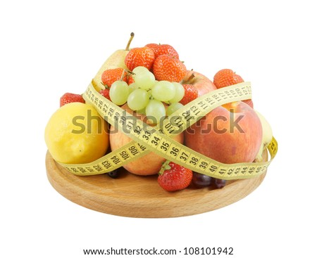 Fresh fruits with measuring tape, fruit diet concept