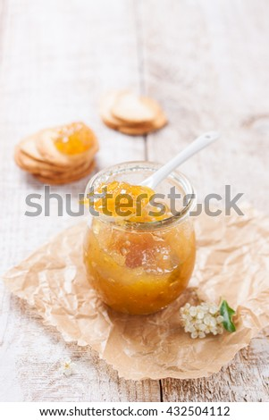Fresh fruity juicy jam with figs in a jar with crackers and cottage cheese for breakfast, closeup with copy space
