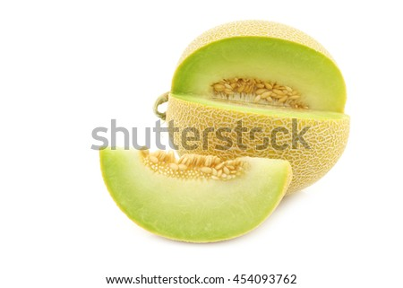 fresh galia melon and a cut piece on a white background - stock photo
