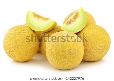 fresh galia melons and some cut pieces on a white background - stock photo