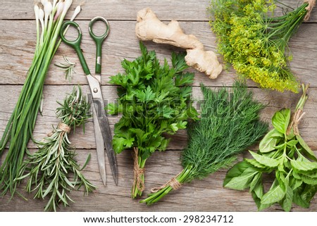 Fresh garden herbs on wooden table. Top view - stock photo