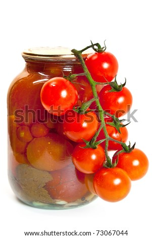 Fresh garden tomatoes. Also a jarred of canned tomatoes on white background - stock photo
