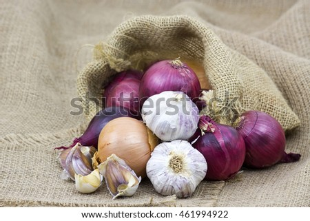 Fresh garlic and onion in package