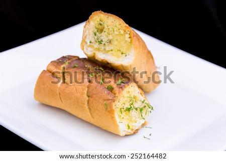 fresh Garlic breads on white plate - stock photo