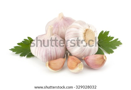 Fresh garlic bulbs with segments and parsley leaves isolated on white background