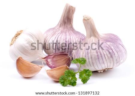 Fresh garlic on white ground - stock photo
