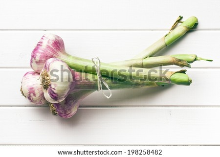 fresh garlic on wooden table - stock photo