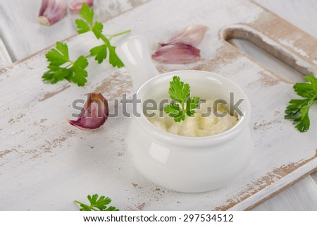 fresh garlic sauce on  white wooden table. Selective focus