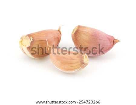 Fresh garlic segments isolated on white background - stock photo