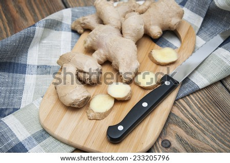 Fresh ginger root on wooden background - stock photo