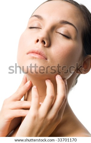 Fresh girl with closed eyes touching her neck over white background