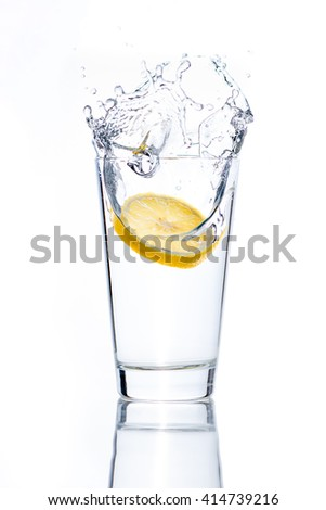 Fresh glass of water with lemon