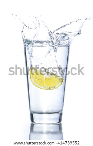 Fresh glass of water with lemon - stock photo