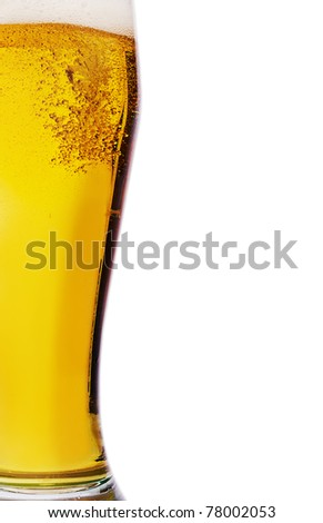 Fresh gold cold and delicious beer in curvaceous glass - stock photo