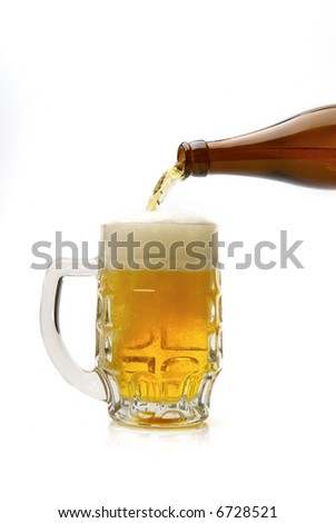 Fresh golden beer in a mug on a white background