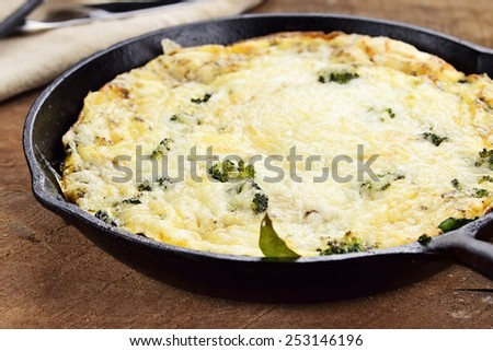 Fresh golden, broccoli, mushroom and spinach frittata with shallow depth of field. - stock photo