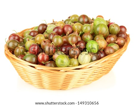 Fresh gooseberries in wicker basket isolated on white