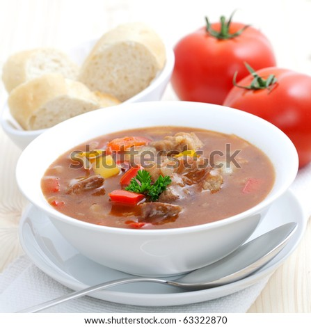 fresh goulash with paprika and baguette