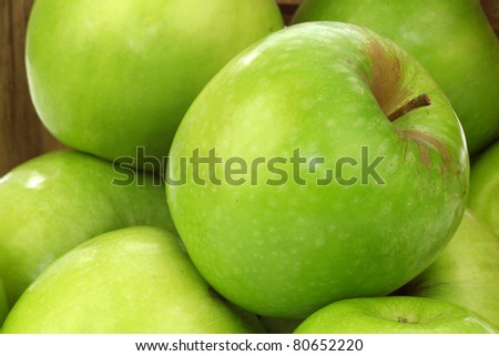 "fresh ""Granny Smith"" apples in a wooden box background"