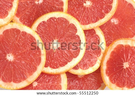 fresh grapefruit and slices on white background