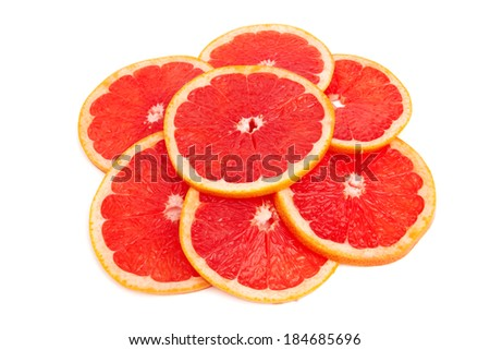Fresh grapefruit slices isolated on a white background