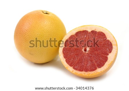 fresh grapefruit with cut on white