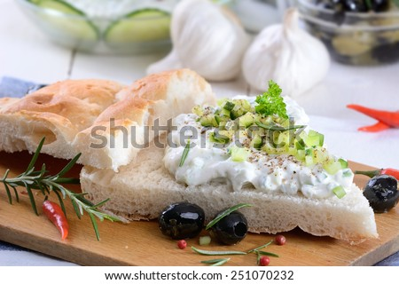 Fresh Greek tzatziki on pita bread - stock photo