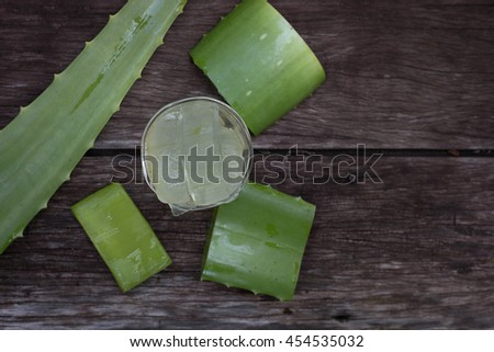 Fresh green aloe vera color green on wooden