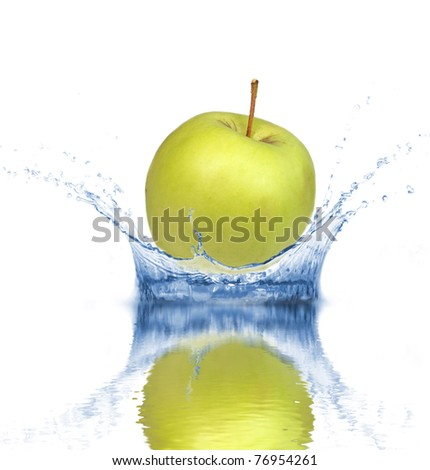 Fresh green apple dropped into water, isolated on white background