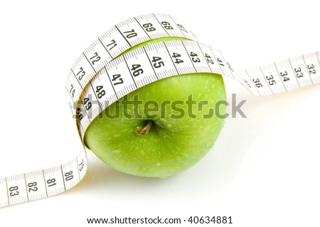 Fresh green apple with measure tape isolated on white background