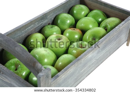 fresh green apples in vintage grey box ready to sell isolated on white background