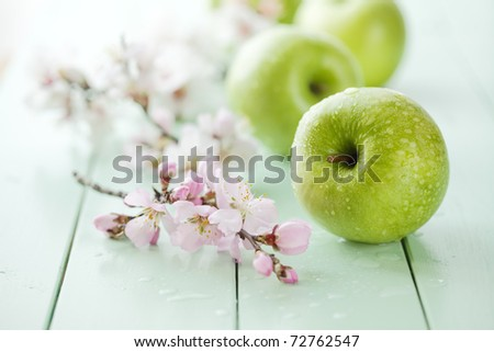 fresh green apples with water drops, shallow dof - stock photo