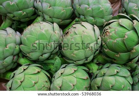 Fresh green artichoke on the market - stock photo