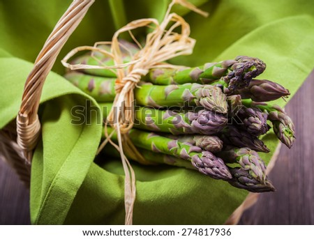 Fresh green asparagus in basket - stock photo