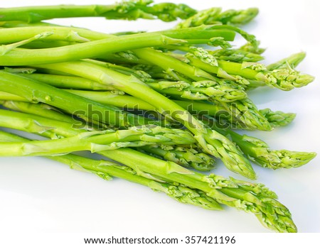 Fresh green asparagus on white  - stock photo