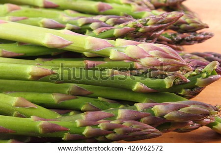 Fresh green asparagus on wooden surface, concept of healthy food, nutrition and strengthening immunity