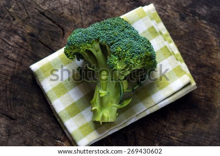 Fresh green broccoli on wooden background   - stock photo