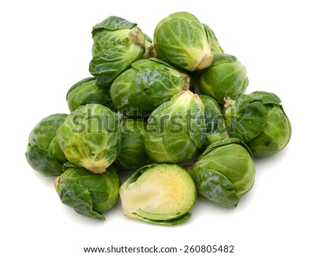 fresh green brussel sprouts on white background - stock photo