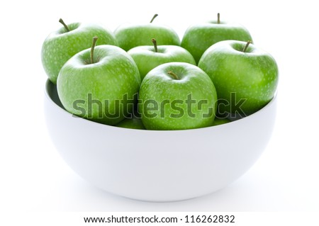 fresh green granny smith apples in a white bowl