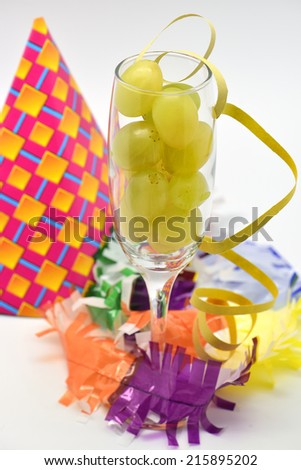 Fresh green grapes in glass for new year celebration  on party background - stock photo
