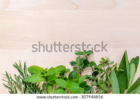 Fresh green herbs harvest from garden on wooden rustic background . - stock photo