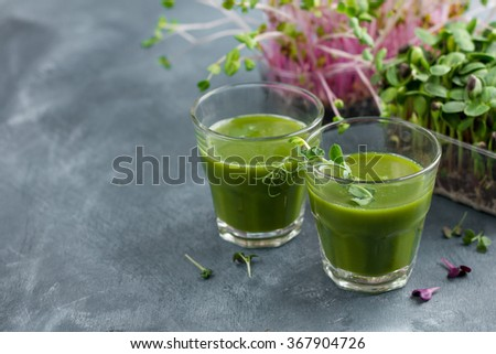 Fresh green juice in the glass for detox, selective focus