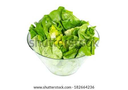 Fresh green lettuce leafs in glass bowl