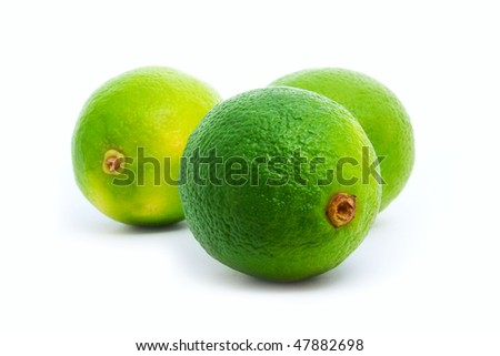 fresh green limes isolated on white