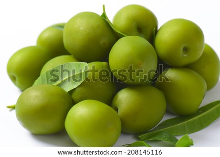 Fresh green olives on white background
