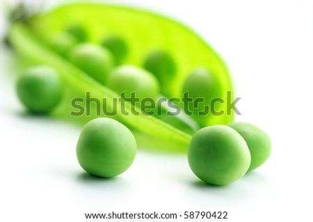 Fresh green pea pod and peas on white background. - stock photo