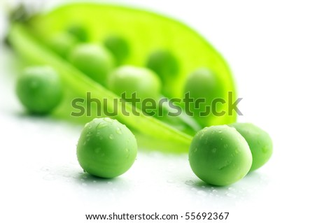 Fresh green pea pod and peas with water drops on white background. - stock photo