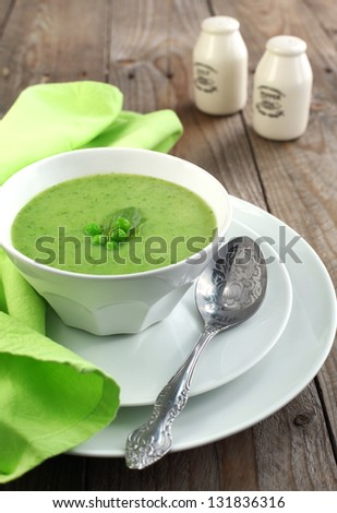 Fresh green pea soup (Selective Focus, Focus on the pea in the m - stock photo