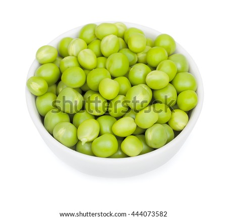Fresh green peas in a litlle white ceramic bowl. Isolated on white background, close-up, top view.